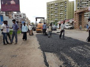 IMG-20160721-WA008 Filling up of Potholes on Kunal Icon Road | filling up of potholes on kunal icon road